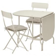 طاولة وكرسيان قابلان للطي
